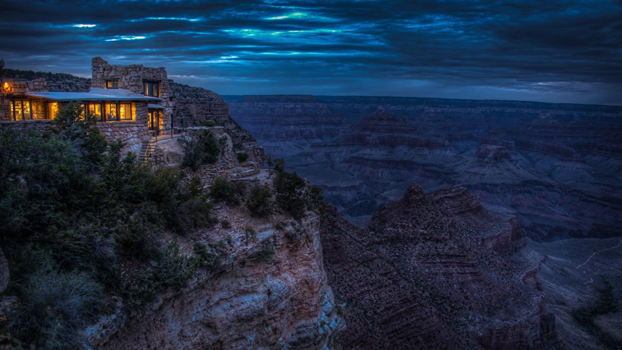 Фотографии Гранд-Каньон парк Горы скале Природа парк Вечер Дома гора Утес скалы Скала Парки Здания