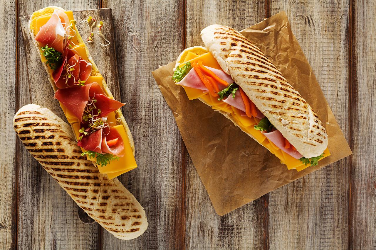 Картинки вдвоем Сэндвич Хлеб Ветчина Продукты питания Доски 2 Двое Еда Пища