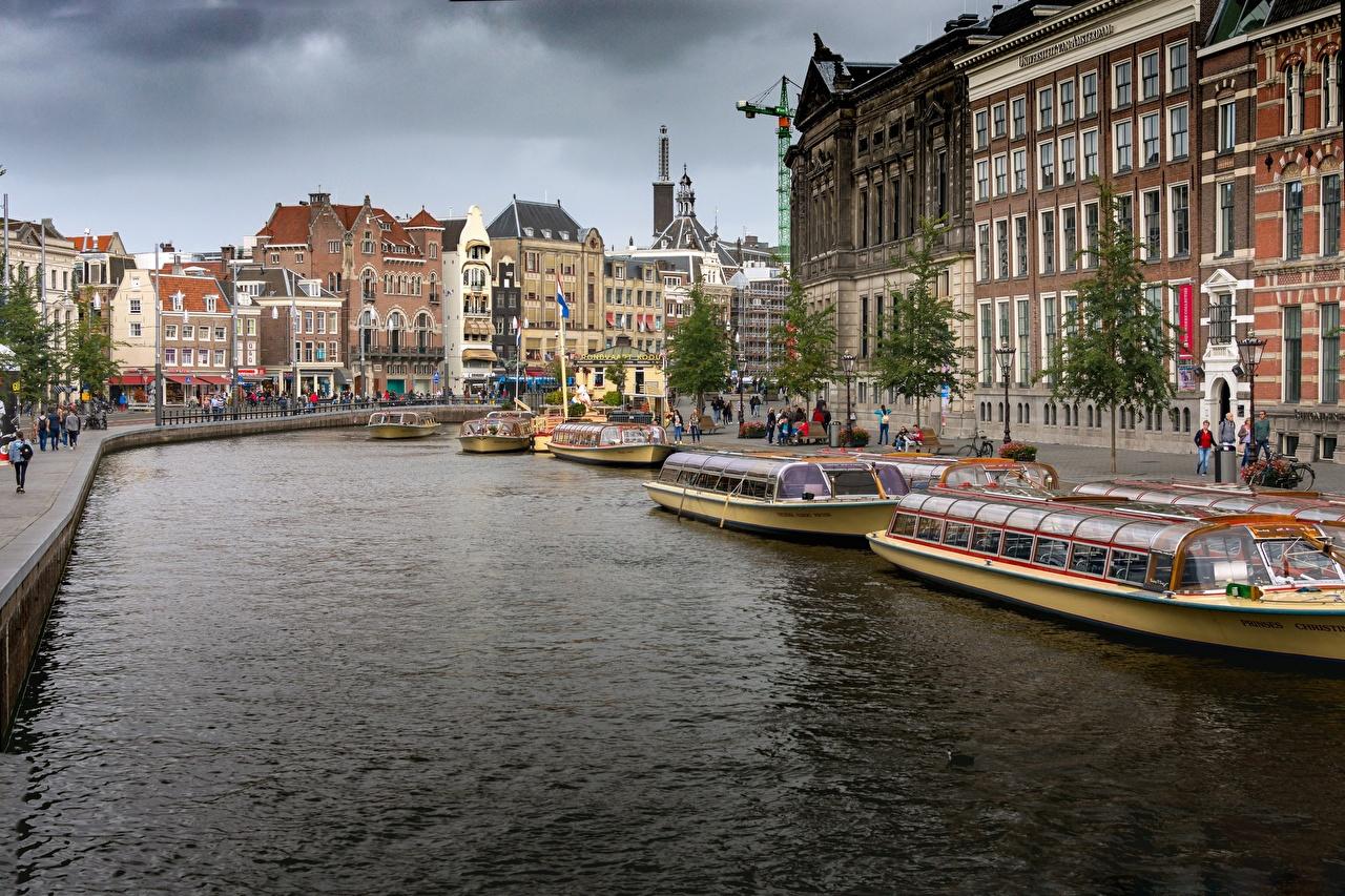 Фотографии Амстердам Нидерланды Водный канал Речные суда Пирсы город Причалы Пристань Города