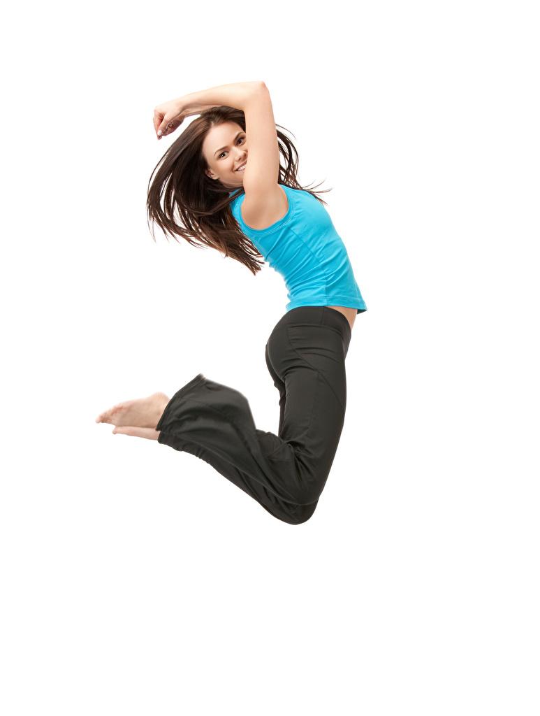 Фотография Шатенка счастливый молодая женщина в прыжке Белый фон  для мобильного телефона шатенки Радость счастье радостная радостный счастливые счастливая девушка Девушки молодые женщины Прыжок прыгать прыгает белом фоне белым фоном