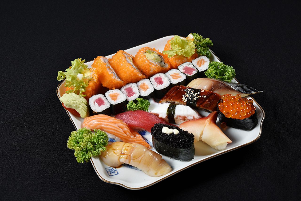 Картинки Рыба суси Пища Черный фон Морепродукты Суши Еда Продукты питания