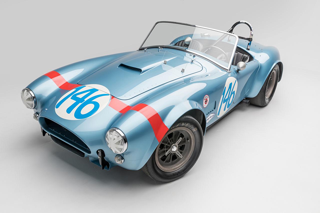 Фотографии SSC 1964 Shelby Cobra 289 FIA Competition Родстер Кабриолет Винтаж Голубой Авто Серый фон Shelby Super Cars Ретро старинные Машины Автомобили