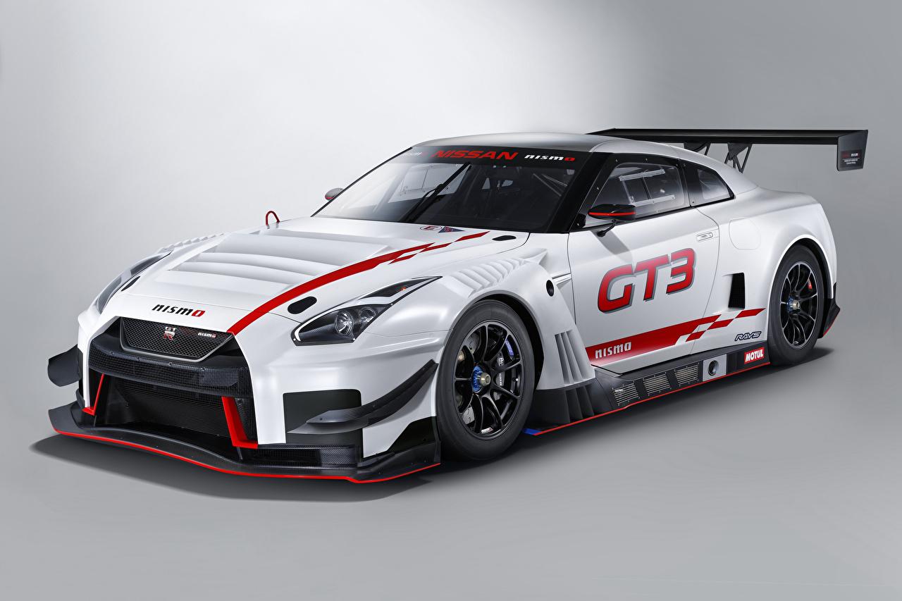 Фотографии Тюнинг Ниссан 2018 Nismo GT-R GT3 Белый машина Серый фон Nissan Стайлинг белых белые белая авто машины автомобиль Автомобили сером фоне