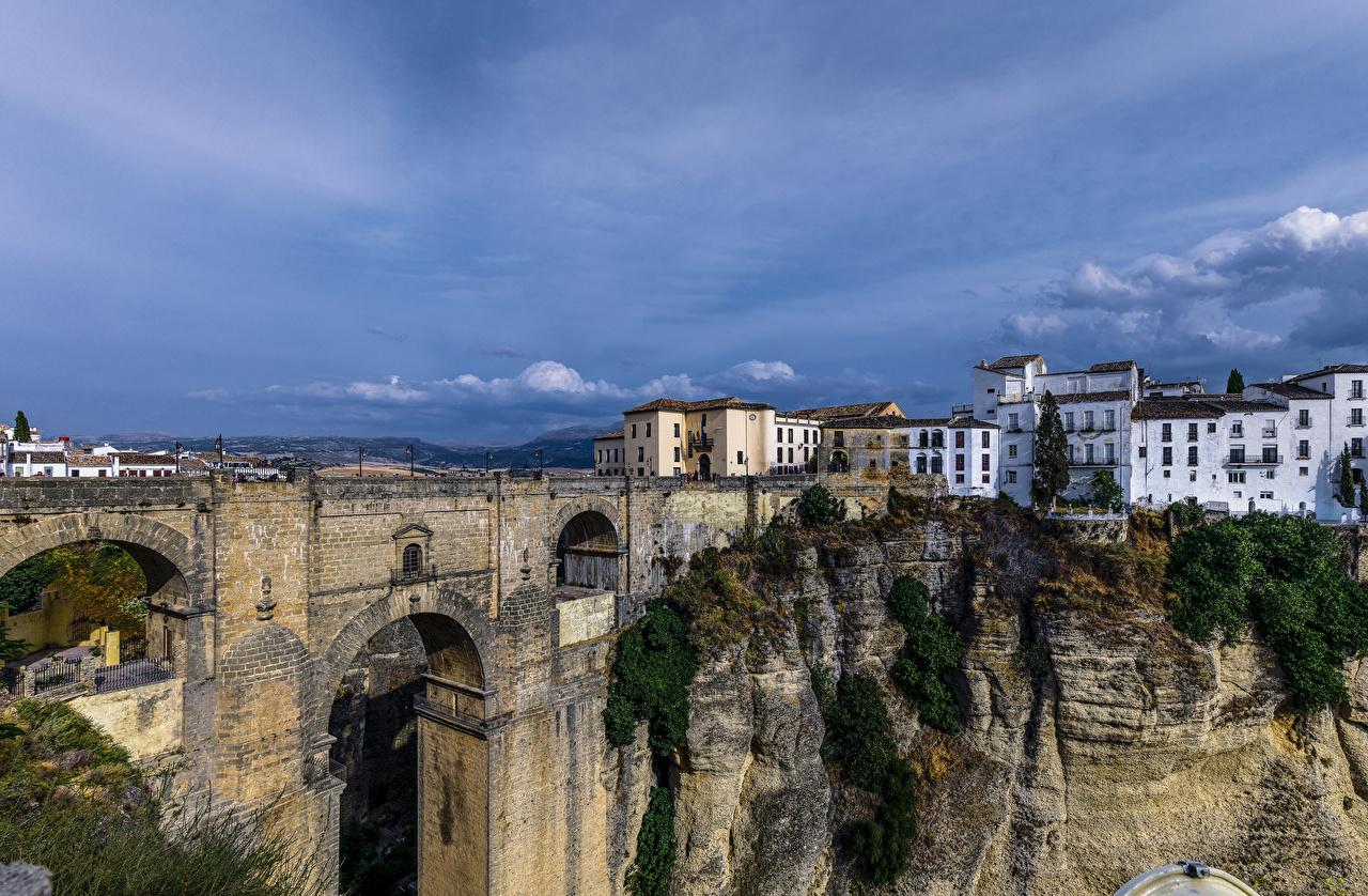 Обои для рабочего стола Испания Ronda Andalusia Утес Мосты Дома Города мост скалы Скала скале город Здания