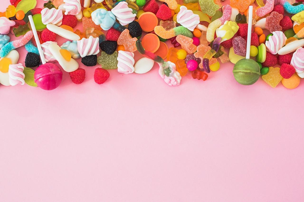 Фотография Леденцы Конфеты Мармелад Продукты питания Сладости Цветной фон Еда Пища сладкая еда