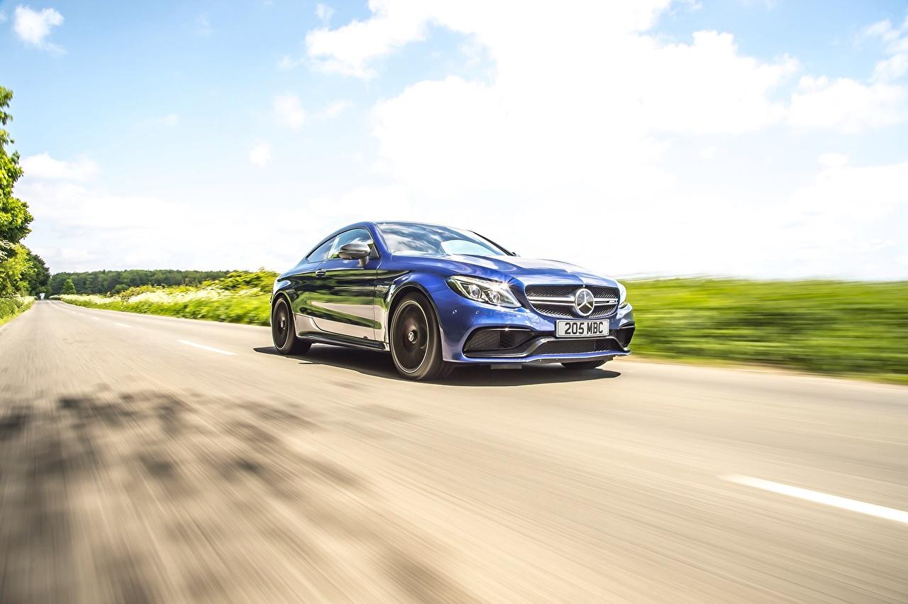 Картинка Mercedes-Benz AMG C 63 Coupe Синий едущий Автомобили Мерседес бенц синих синие синяя едет едущая скорость Движение авто машина машины автомобиль