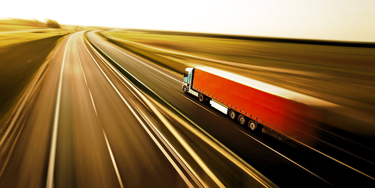 Обои для рабочего стола Грузовики Дороги Движение авто едет едущий едущая скорость машина машины Автомобили автомобиль