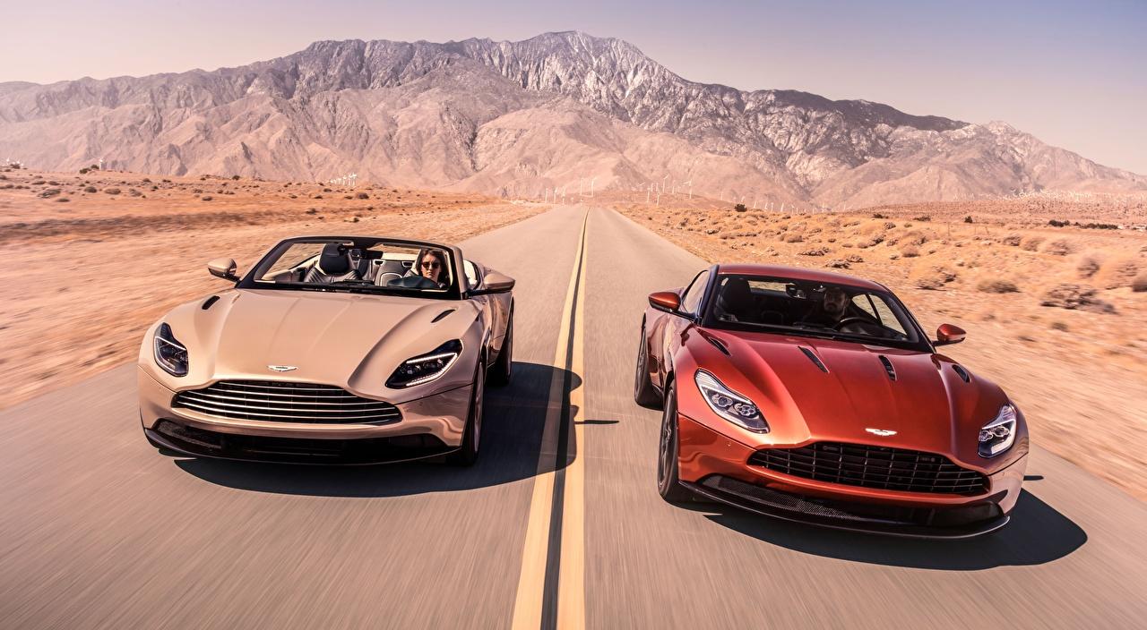 Фотографии Aston Martin DB11, V8, Volante, 2018 кабриолета 2 Дороги Движение машина Астон мартин Кабриолет два две Двое вдвоем едет едущий едущая скорость авто машины Автомобили автомобиль