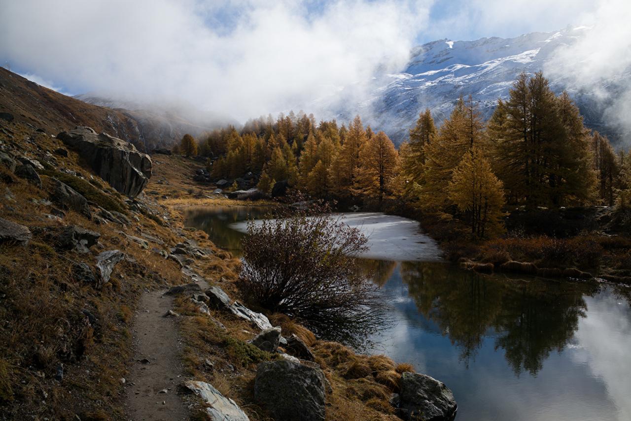 Фотография Альпы Швейцария Grindjisee Горы Осень Природа Озеро Камень облачно альп гора осенние Камни Облака облако