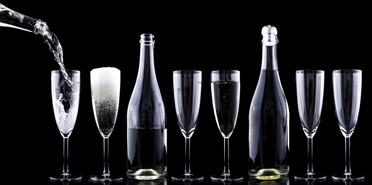 Картинки Шампанское бокал Бутылка на черном фоне Игристое вино Бокалы бутылки Черный фон