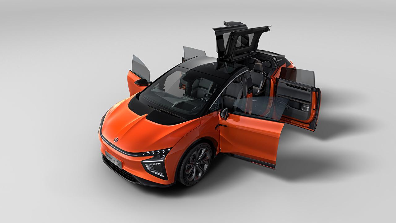 Фотография китайский CUV Открытая дверь HiPhi X, 2020 Оранжевый авто Сверху Металлик Серый фон Китайские китайская Кроссовер оранжевая оранжевые оранжевых машина машины Автомобили автомобиль сером фоне