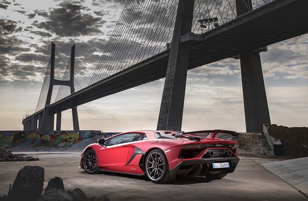 Фотографии Ламборгини Aventador SVJ 2018 Мосты красные Автомобили Lamborghini красных Красный красная авто машина машины автомобиль
