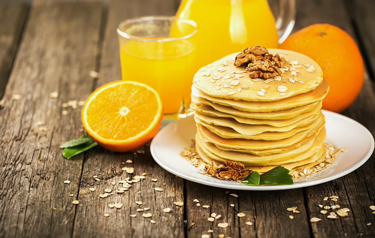 Картинки Блины Апельсин Еда тарелке Орехи Доски Пища Тарелка Продукты питания
