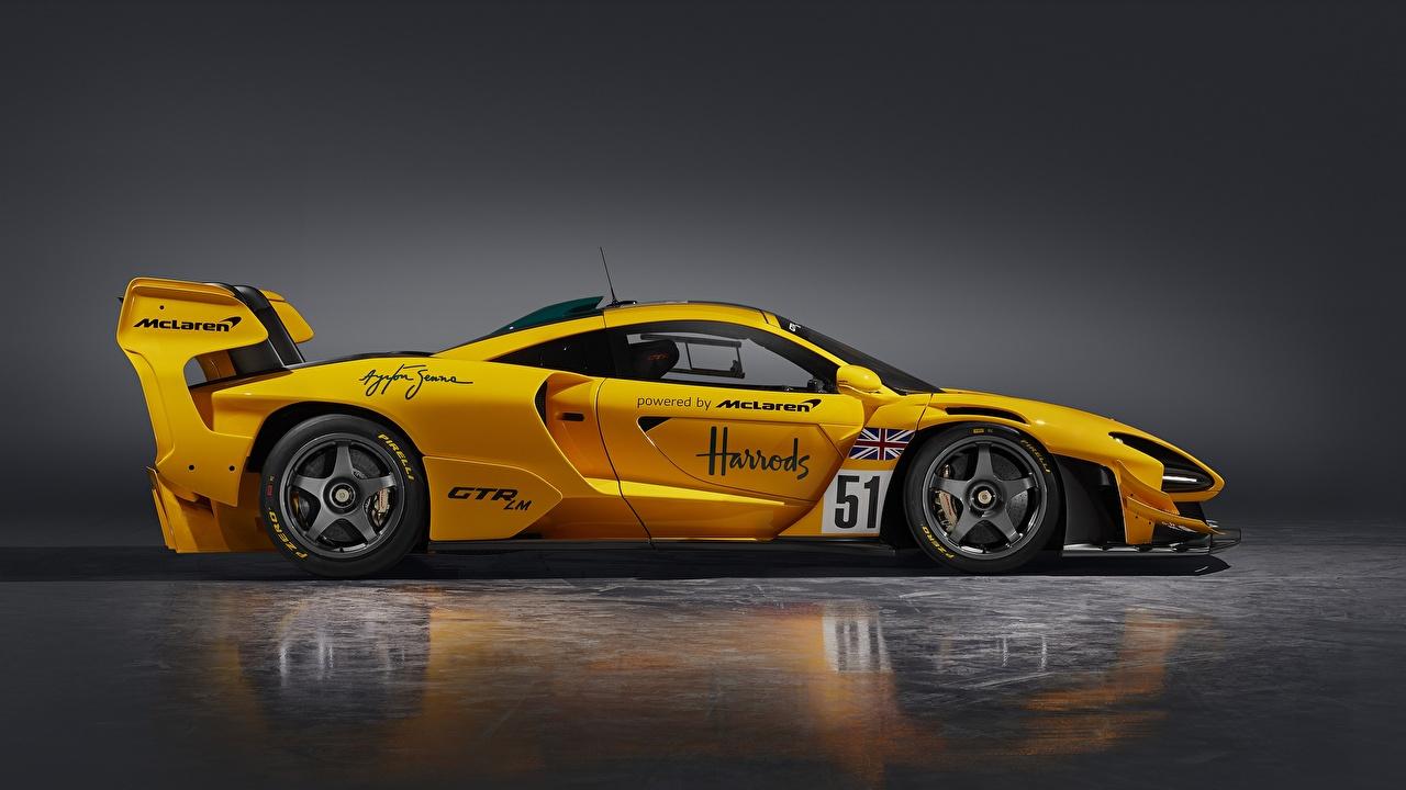 Картинки McLaren Senna GTR LM, 2020 Купе желтых Сбоку машины Металлик Макларен желтая желтые Желтый авто машина Автомобили автомобиль
