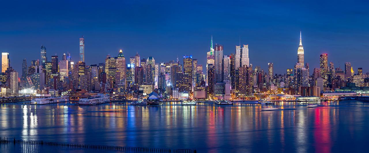 Картинки Нью-Йорк штаты Реки Ночные Небоскребы Дома Города США америка река Ночь речка ночью в ночи город Здания