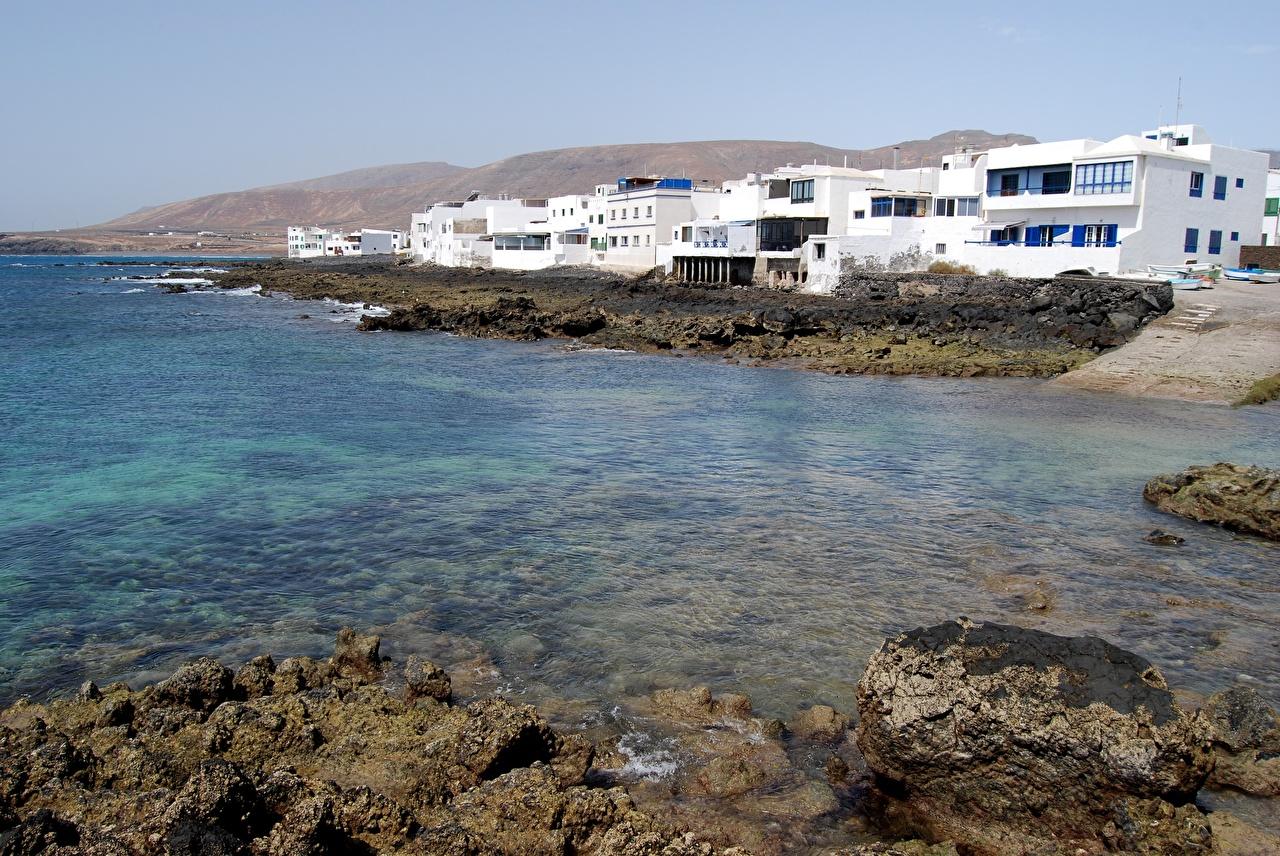 Фото канарские острова Испания Lanzarote Остров берег Камень Города Канары Камни Побережье город