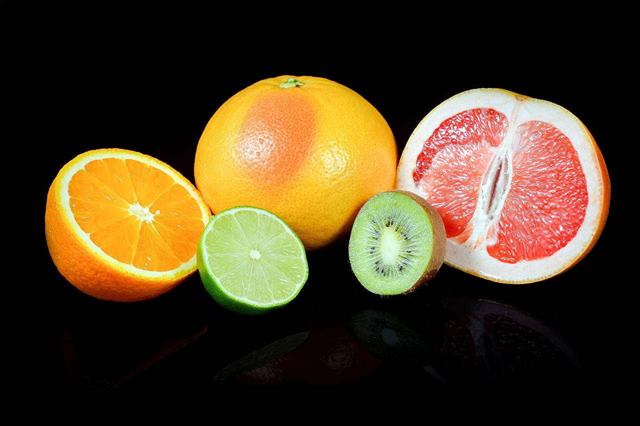 Фотографии Апельсин Грейпфрут Мандарины Киви Пища Черный фон Цитрусовые Еда Продукты питания