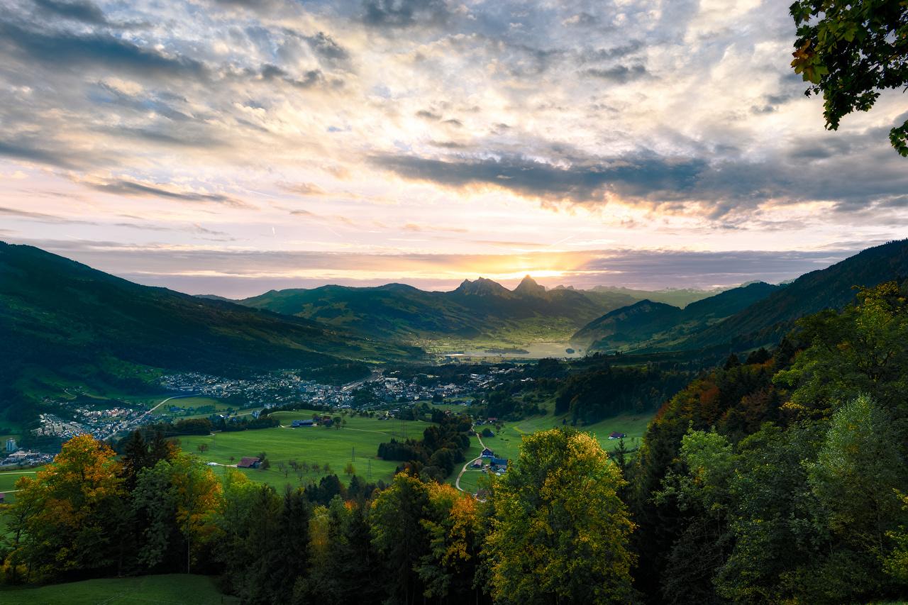 Обои для рабочего стола альп Швейцария Lake Lauerz, Arth-Goldau Долина гора Природа Небо Озеро Деревья Альпы Горы дерево дерева деревьев