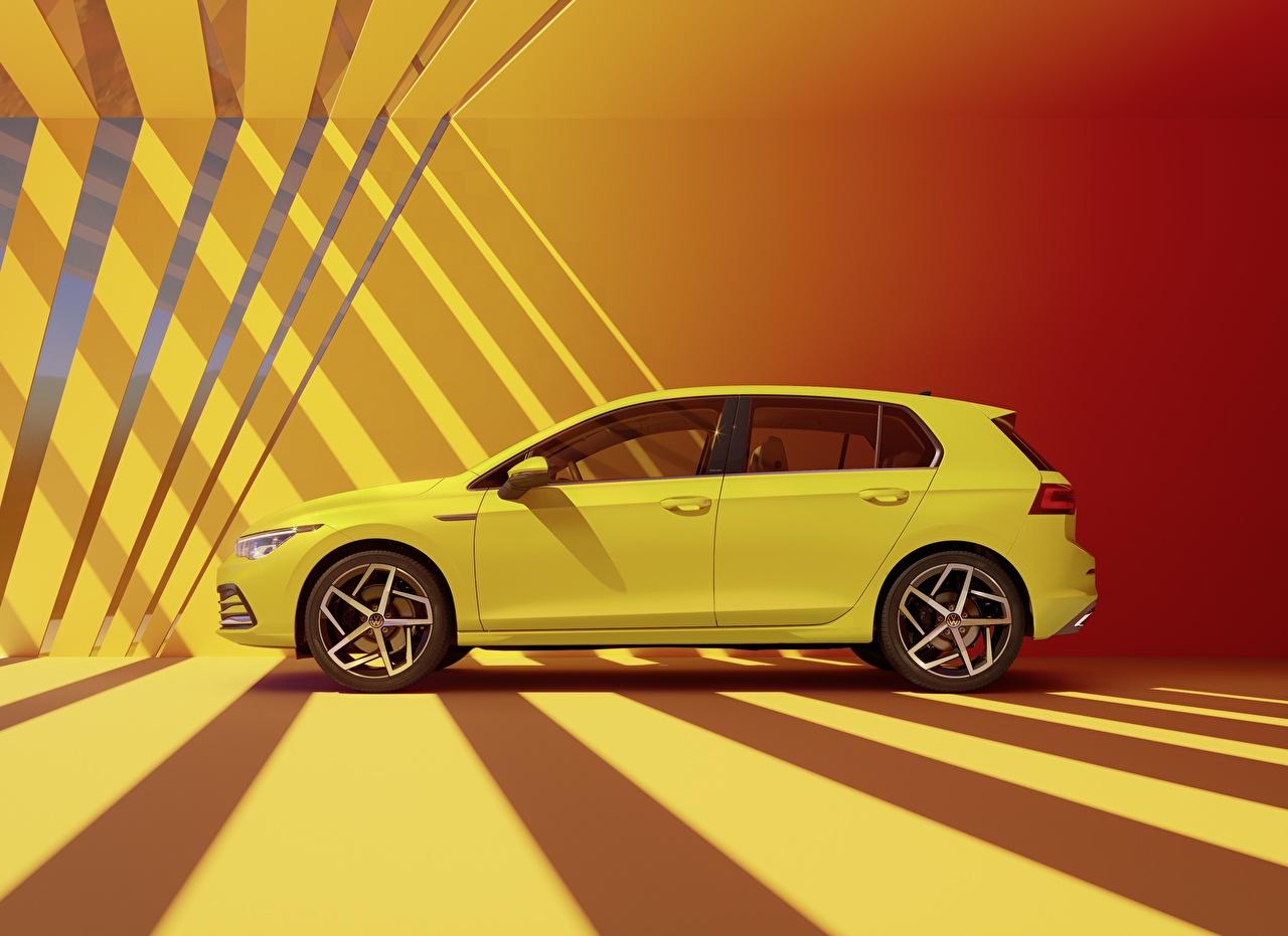 Фото Фольксваген Golf hatchback R-Line 2020 желтых Сбоку машины Volkswagen желтая желтые Желтый авто машина Автомобили автомобиль