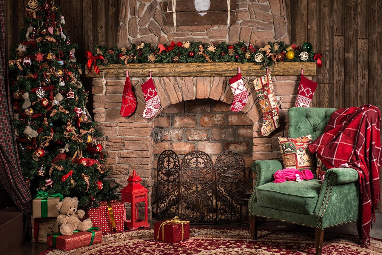 Картинка Рождество Новогодняя ёлка камины Подарки Кресло