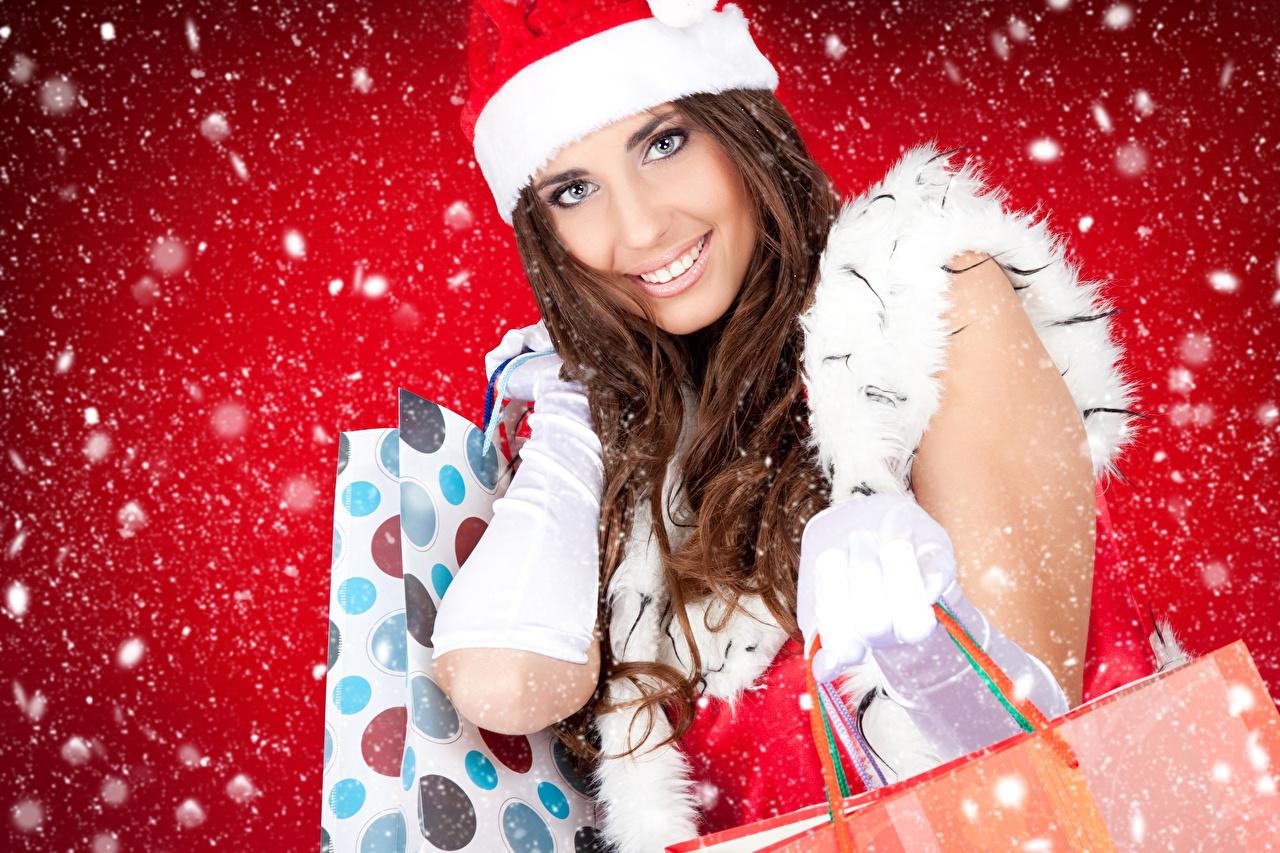 Картинки Шатенка Новый год молодая женщина снега Взгляд шатенки Рождество девушка Девушки молодые женщины Снег снеге снегу смотрят смотрит
