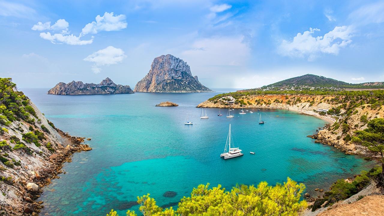 Картинки Испания Ibiza, Balearic archipelago, Mediterranean sea Природа Остров Яхта Залив берег Побережье