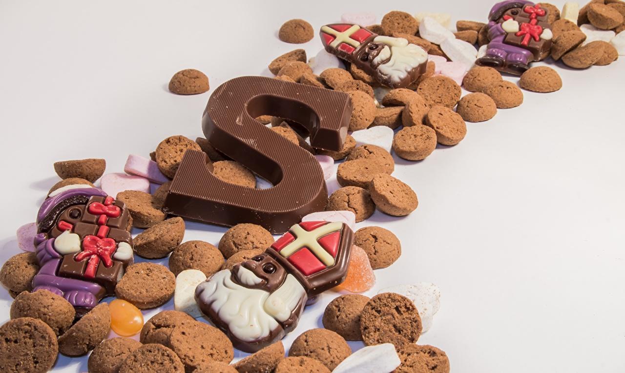 Картинка Шоколад Еда Печенье Много Серый фон Пища Продукты питания сером фоне