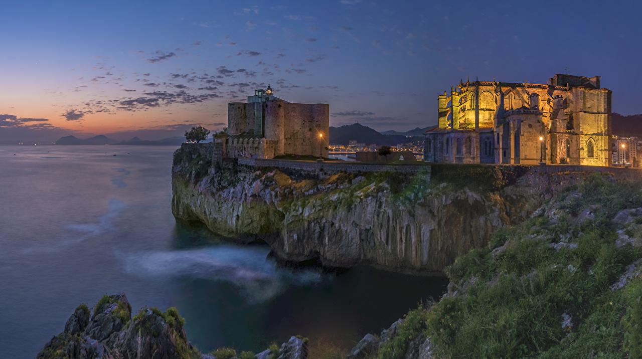 Фотографии Испания Castro Urdiales Cantabria Скала Замки Вечер Города Утес