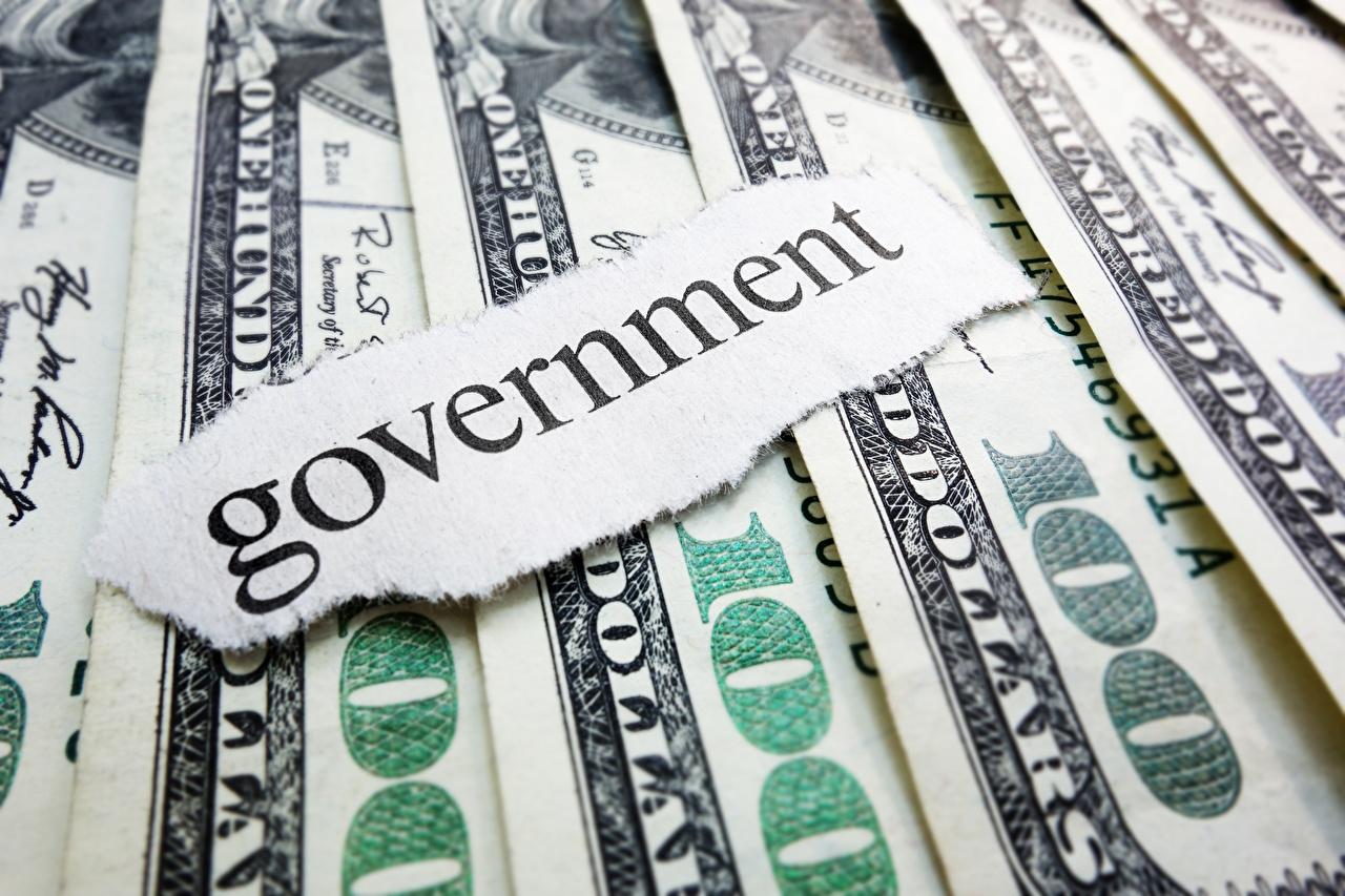 Картинки Доллары Банкноты government Крупным планом Купюры вблизи