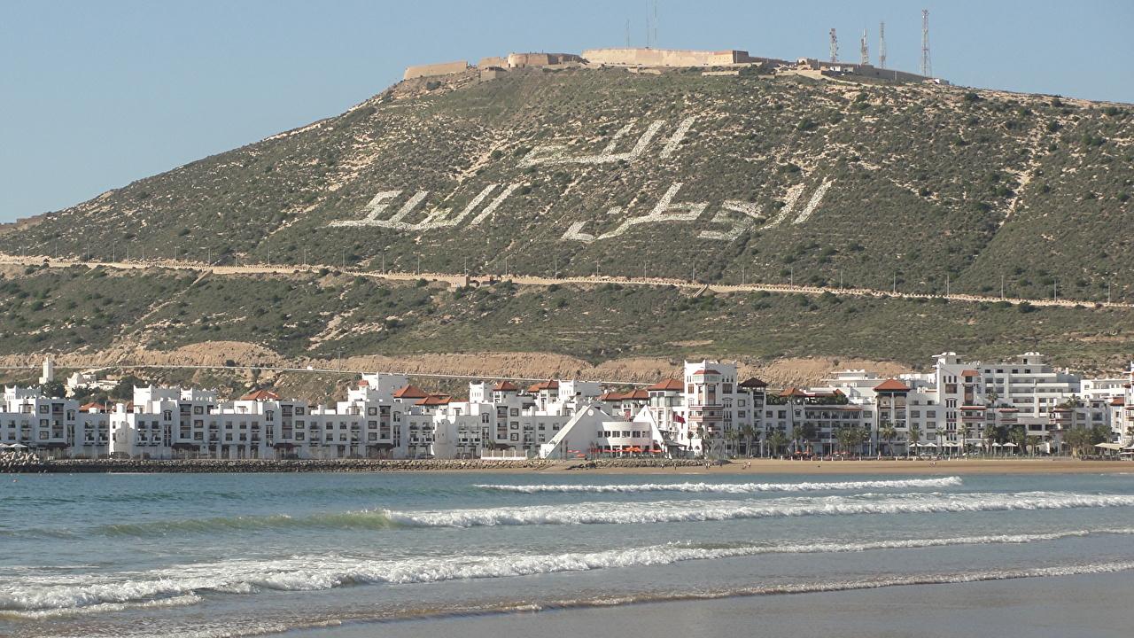 Картинка Марокко Agadir гора Море Побережье Здания Города Горы берег Дома город