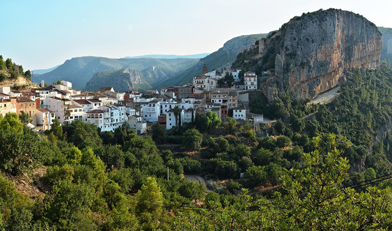 Обои Испания Chulilla Скала Дома Города Деревья Утес скалы скале город дерева дерево Здания деревьев