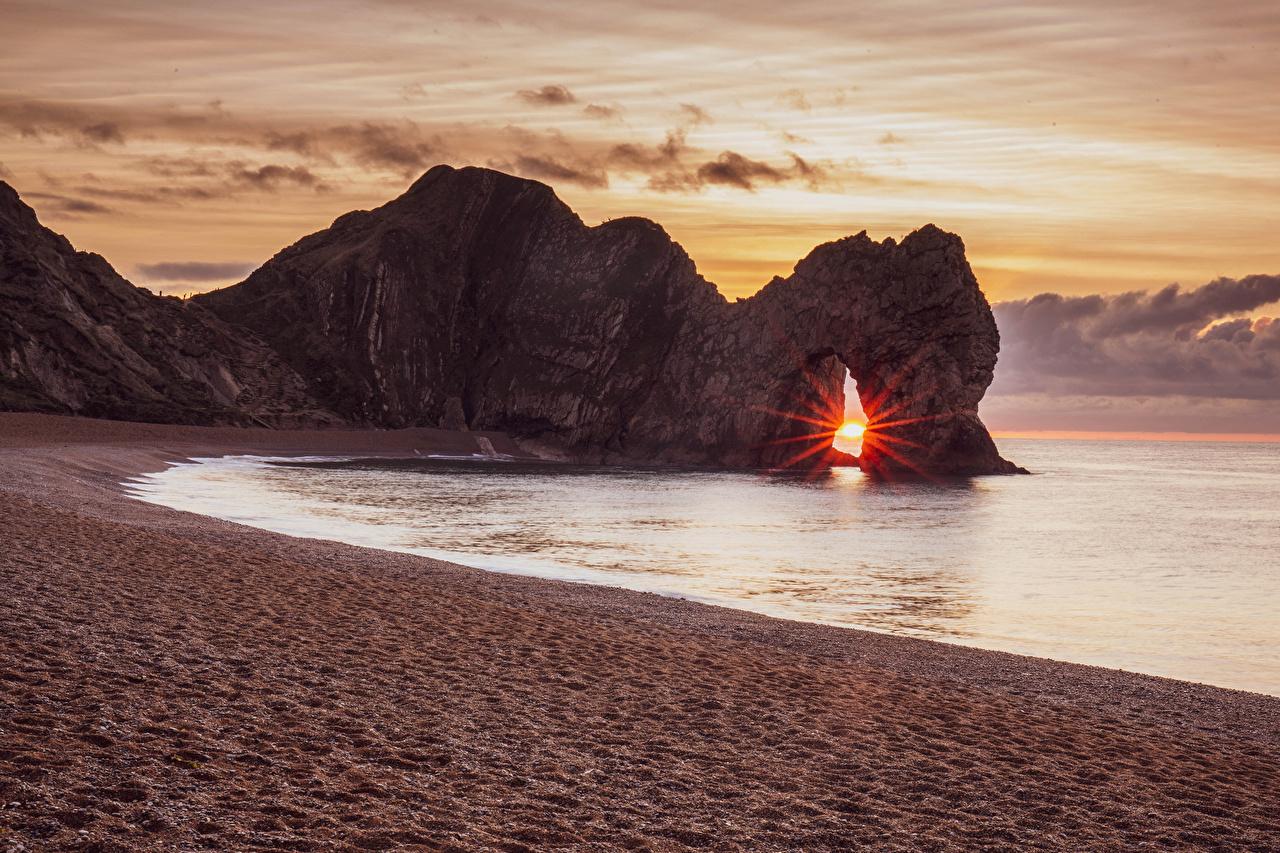 Фото Англия Lulworth Camp Purbeck District Скала Природа песка Рассветы и закаты Побережье Утес скале скалы песке Песок рассвет и закат берег