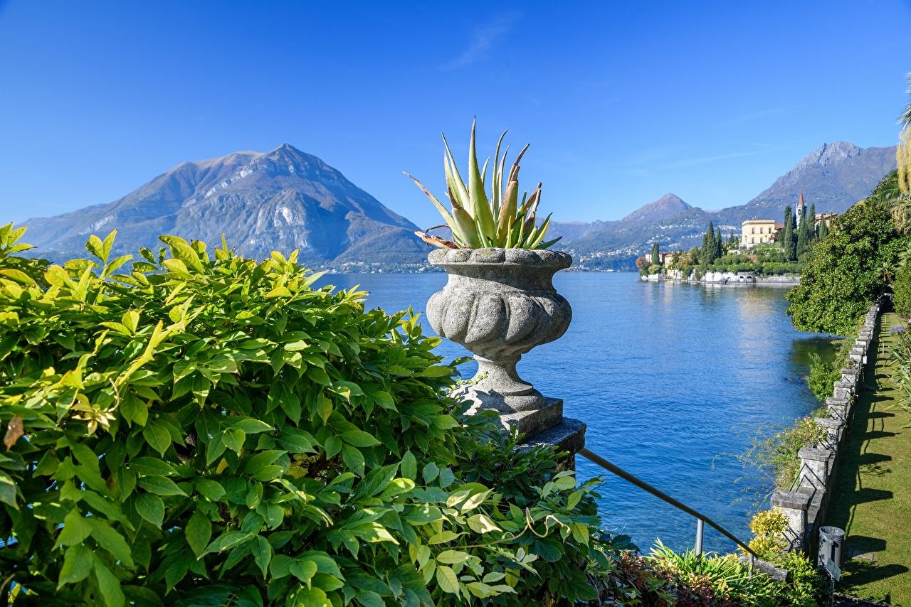 Картинка Альпы Италия Lago di Como, Varenna гора Природа Цветочный горшок Озеро альп Горы
