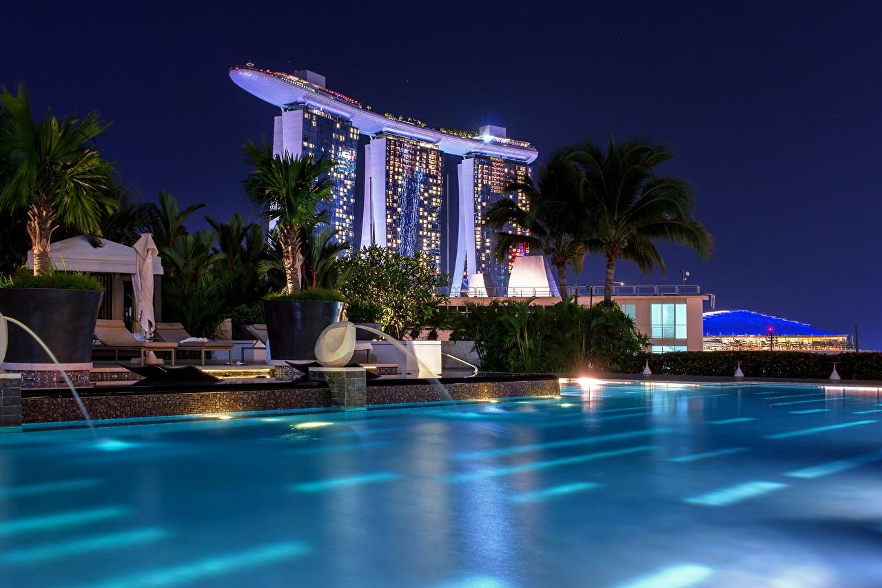Картинки Сингапур Бассейны Marina Bay Sands ночью Города Плавательный бассейн Ночь в ночи Ночные город