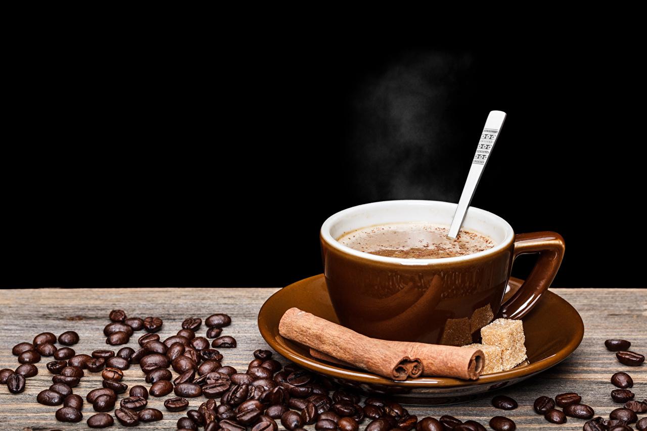 Картинка Кофе Зерна Корица Еда Чашка на черном фоне напиток зерно Пища чашке Продукты питания Черный фон Напитки