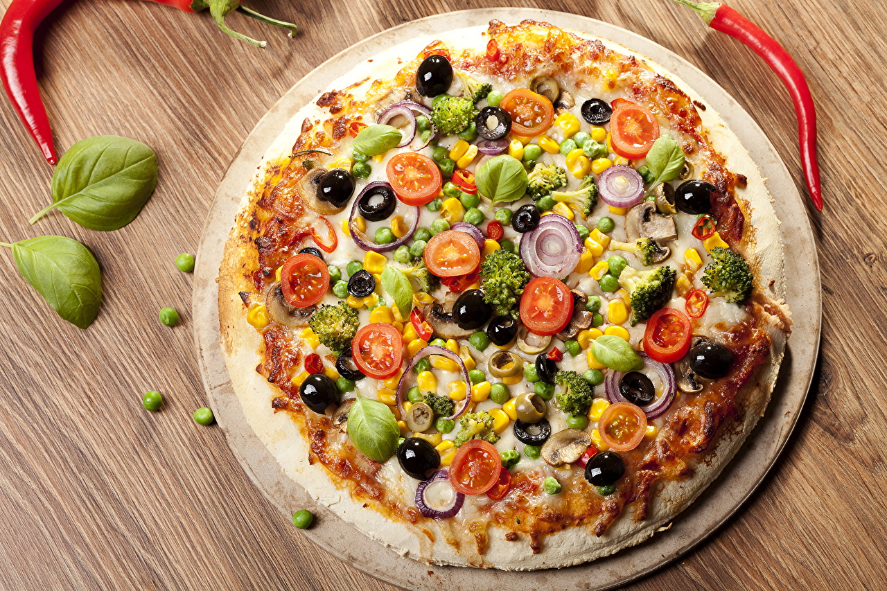 Фотографии Пицца Быстрое питание Пища Овощи вблизи Фастфуд Еда Продукты питания Крупным планом