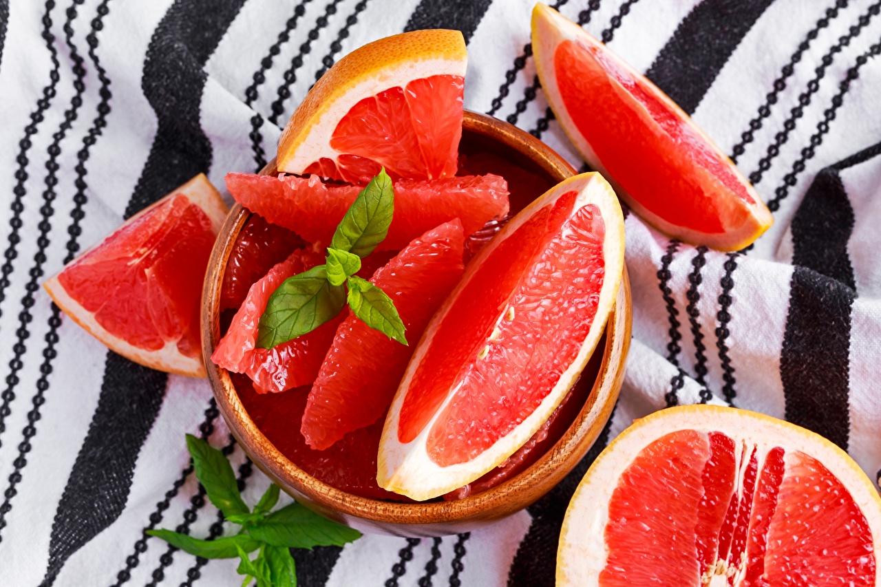 Фотографии Грейпфрут кусочек Пища нарезка часть Кусок кусочки Еда Продукты питания Нарезанные продукты
