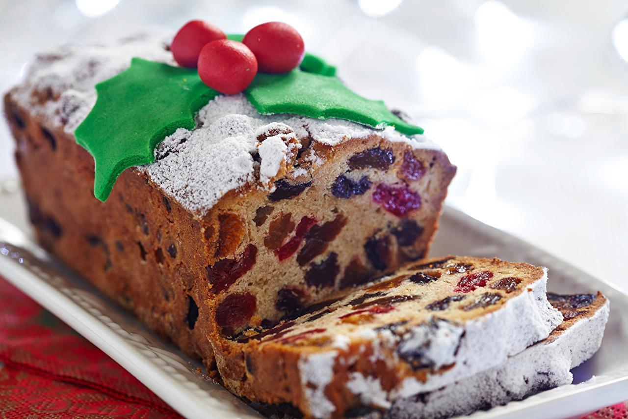 Обои для рабочего стола Новый год Кекс Изюм Сахарная пудра Еда Ягоды Выпечка Рождество Пища Продукты питания