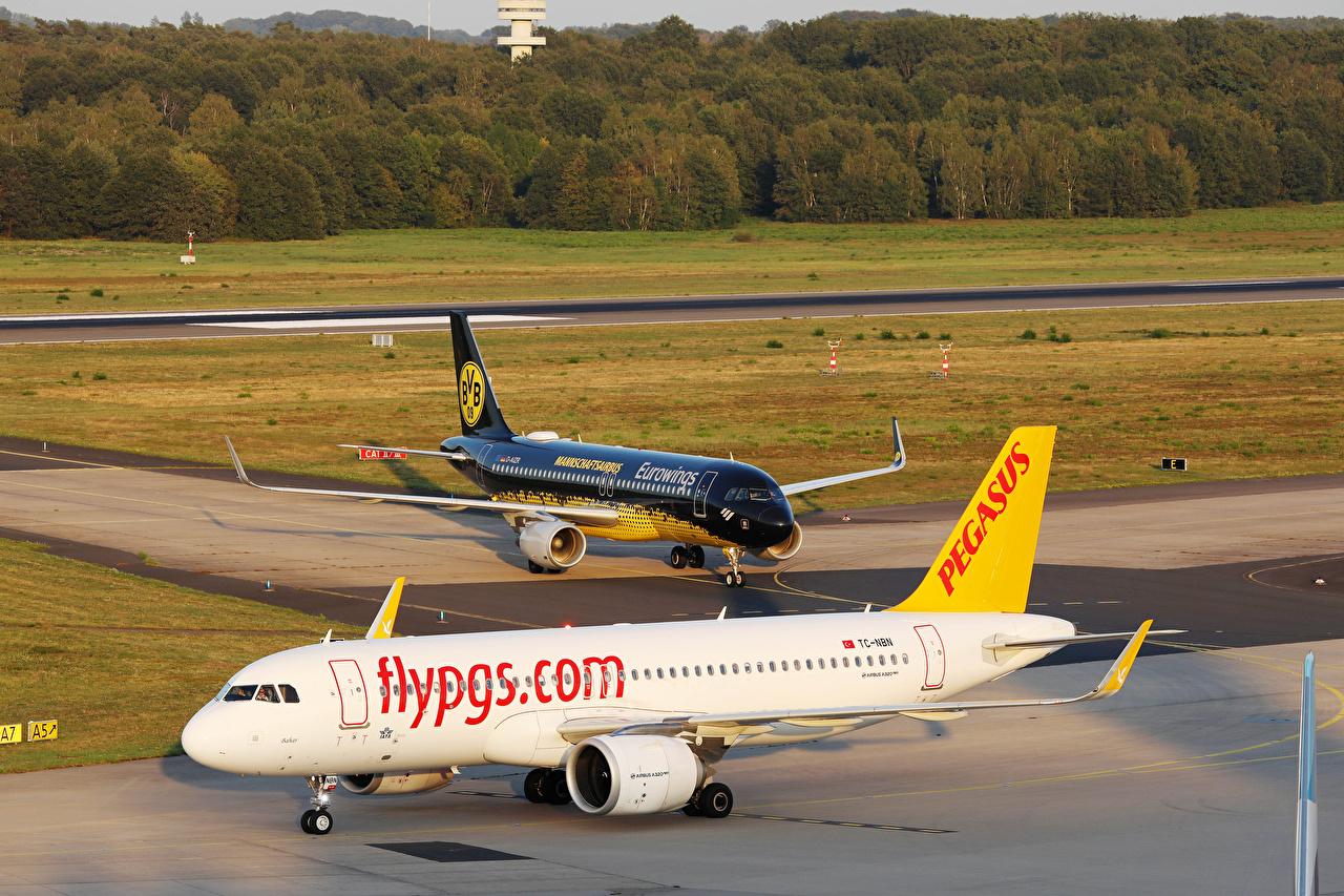 Обои для рабочего стола Самолеты Пассажирские Самолеты Pegasus Airbus A320 neo and Eurowings BVB ivery вдвоем Авиация Эйрбас 2 два две Двое