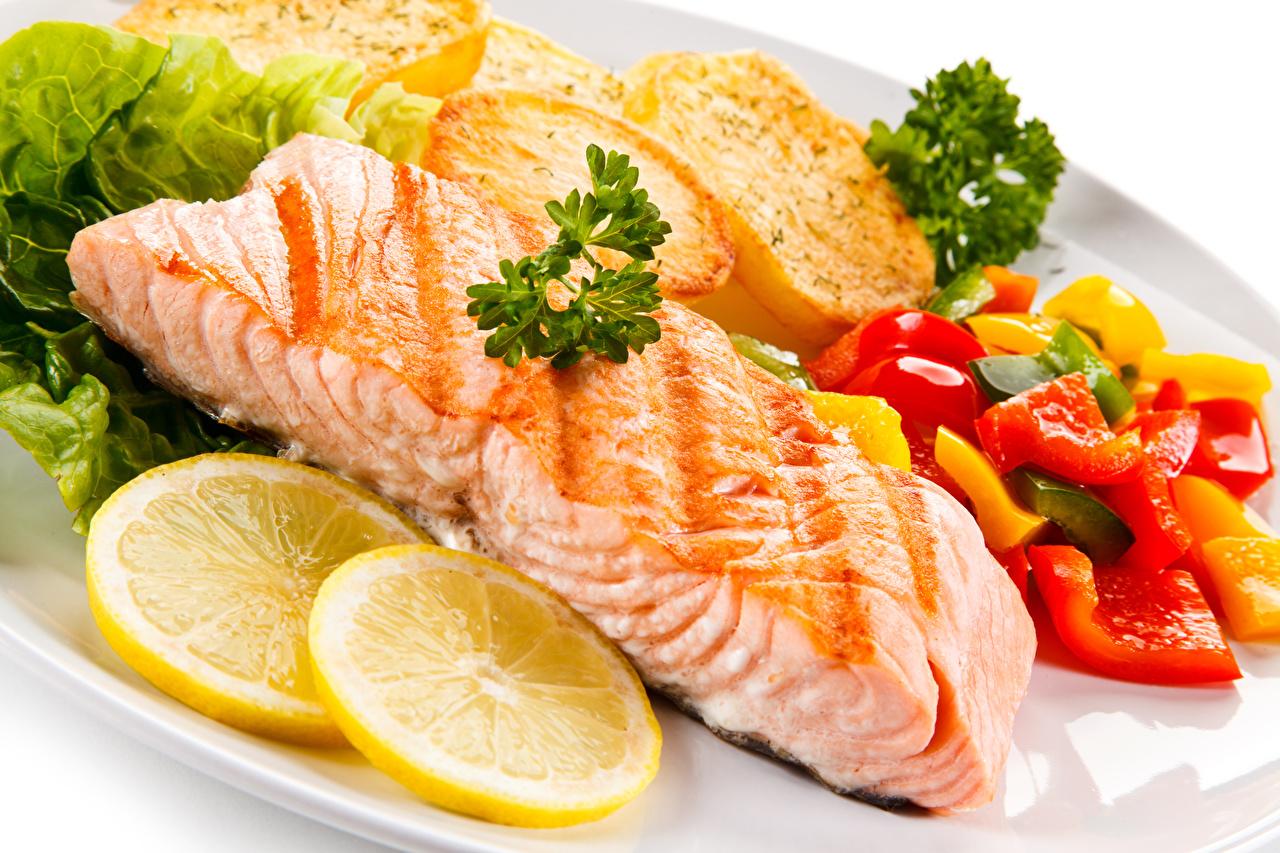 Фотографии Рыба Лимоны Пища Овощи Морепродукты Еда Продукты питания