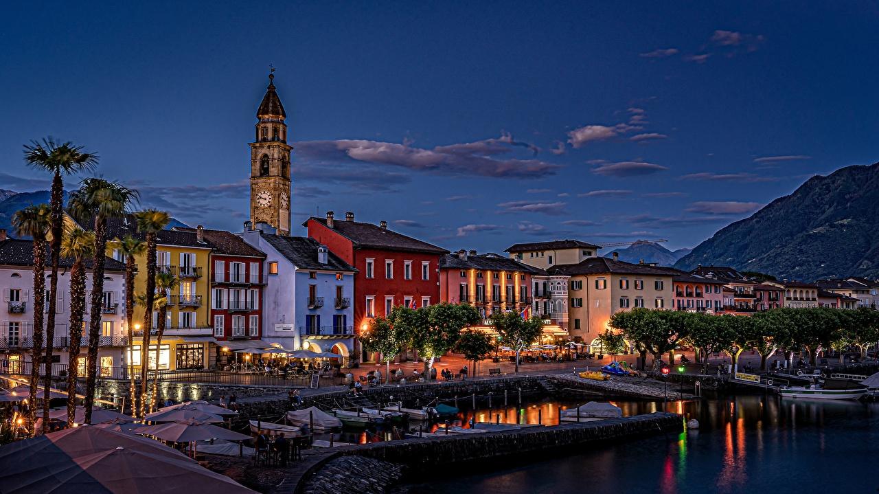 Картинки Швейцария Ascona, Lake Maggiore Озеро Ночь Лодки набережной город Здания ночью в ночи Ночные Набережная Дома Города