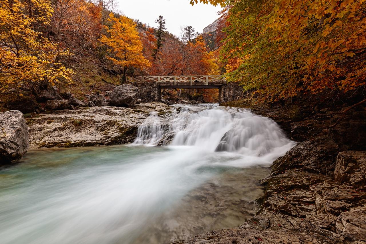 Фотография Испания province Huesca, River, Ordesa national Park and Monte Perdido мост осенние Природа парк Реки Камень Осень Мосты Парки река речка Камни