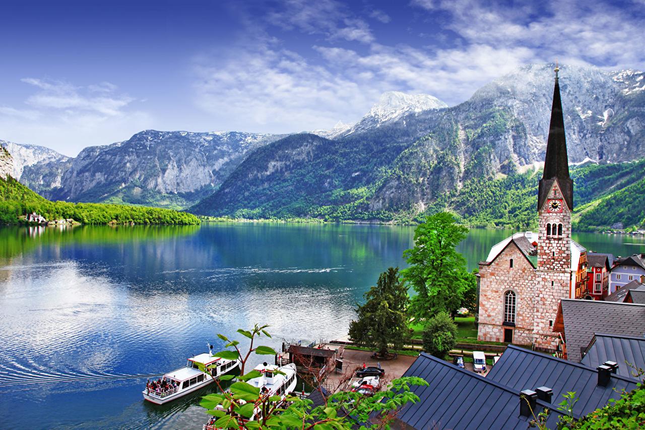 Фото Церковь Халльштатт Австрия Hallstatt lake, Salzkammergut region Горы Озеро Речные суда Пирсы город гора Причалы Пристань Города