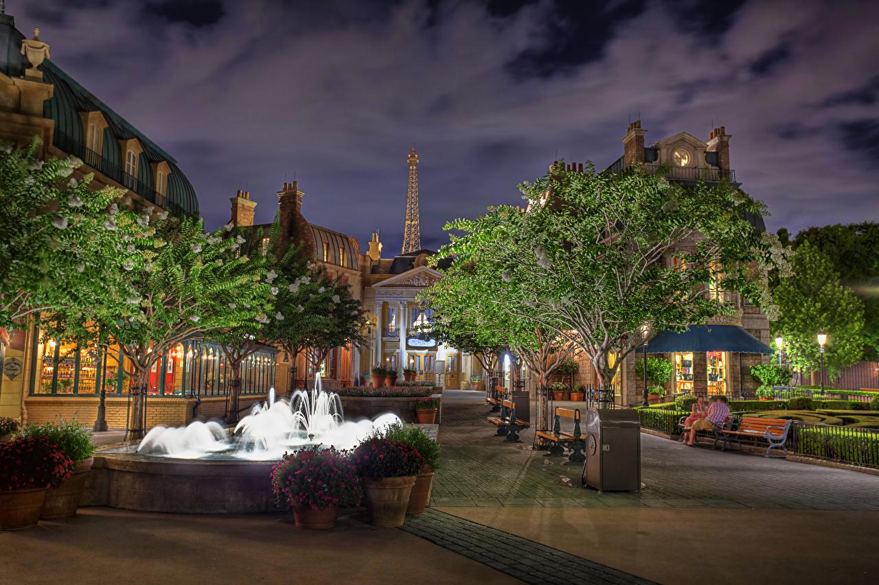 Фото Флорида штаты Фонтаны Epcot Walt Disney World Orlando Парки Вечер Уличные фонари Дома город Деревья Дизайн США парк дерева Здания дерево Города деревьев дизайна