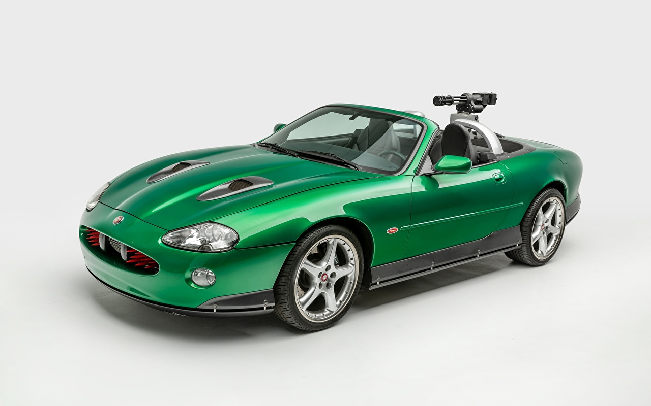 Картинки Jaguar xkr james bond die another day Кабриолет зеленых авто сером фоне Ягуар кабриолета зеленая зеленые Зеленый машина машины Автомобили автомобиль Серый фон