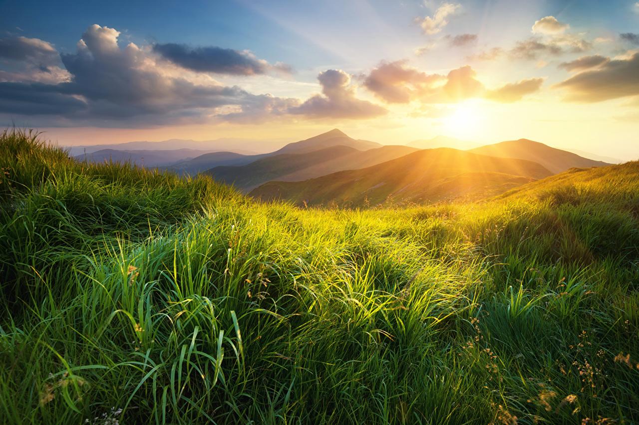 Обои Природа Холмы Рассветы и закаты Трава Облака