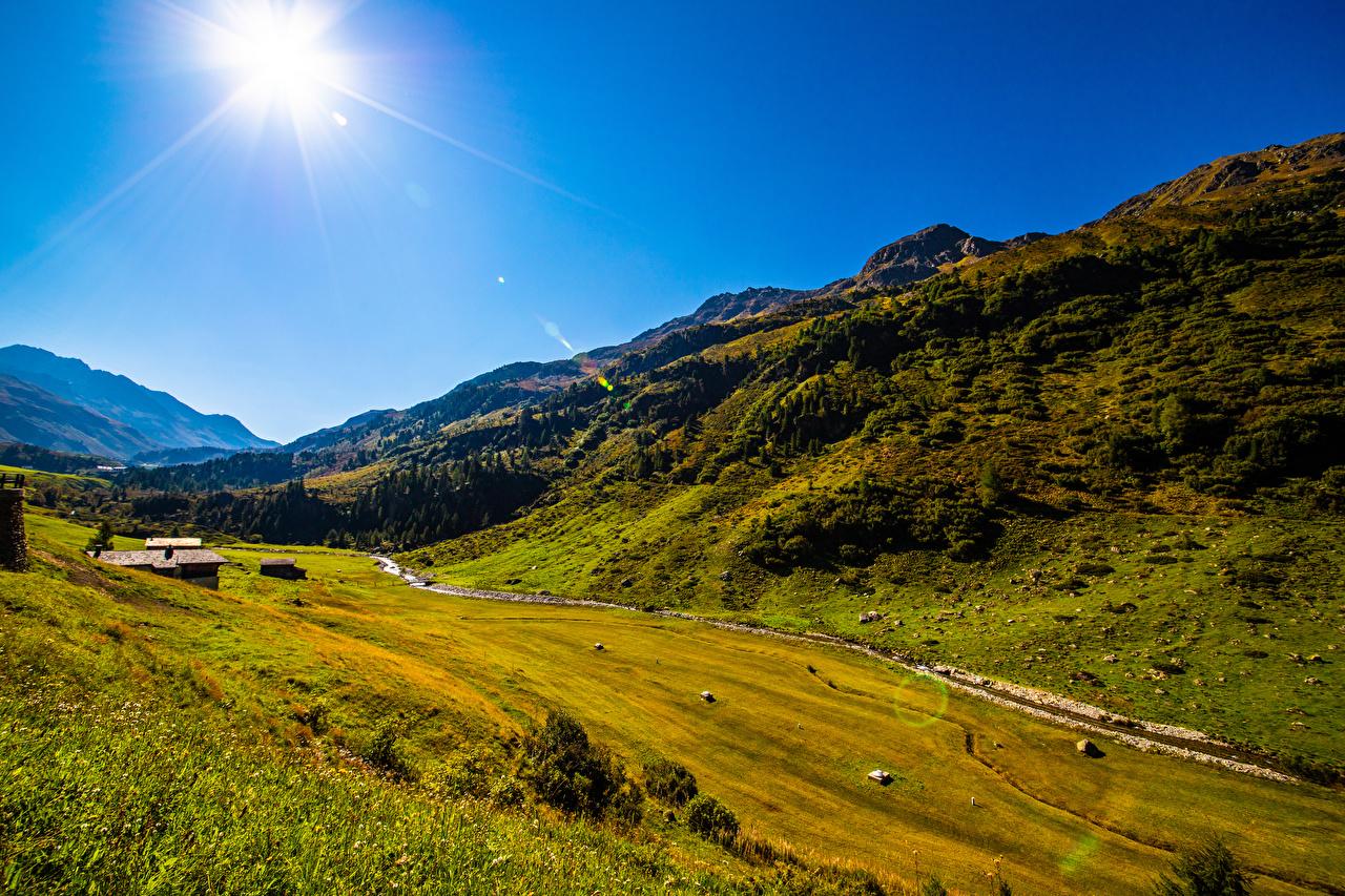 Фотографии Швейцария Graubünden гора Солнце Природа Небо Горы солнца