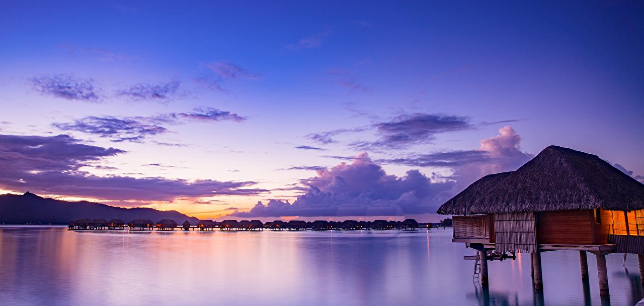 Фотография Бора-Бора Французская Полинезия Бунгало Море Природа Небо Тропики Рассветы и закаты Вечер