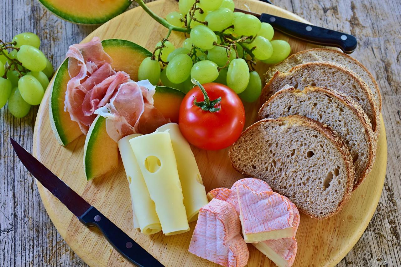 Фото Нож Помидоры Сыры Хлеб Ветчина Виноград Еда ножик Томаты Пища Продукты питания
