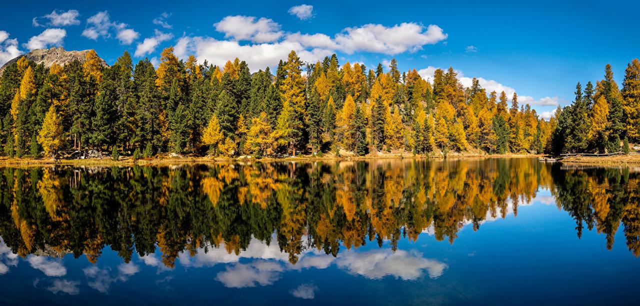 Картинки Швейцария Lai Nair Осень Природа Леса Озеро Отражение Облака деревьев осенние лес отражении отражается дерево дерева облако Деревья облачно